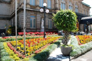 building with flowers and statues