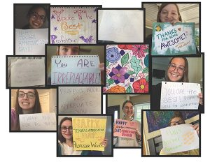 Students holding appreciation signs on Zoom